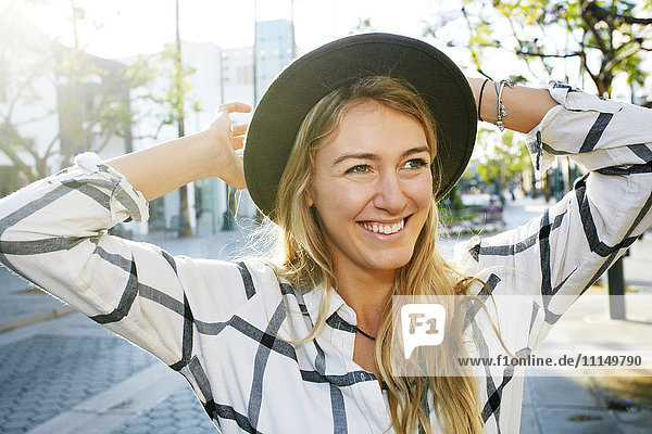 Caucasian woman smiling outdoors Caucasian woman smiling outdoors