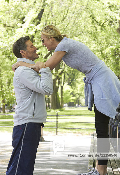 Caucasian couple playing in park