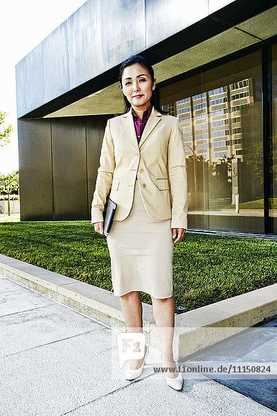 Asian businesswoman standing at modern office