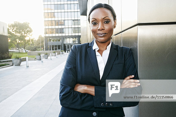Black businesswoman smiling outdoors
