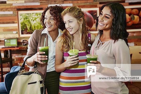 Women having juice together in cafe