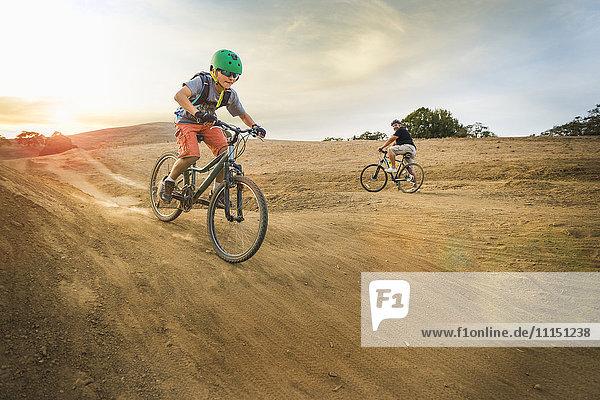 Boy riding dirt bikes on track Boy riding dirt bikes on track