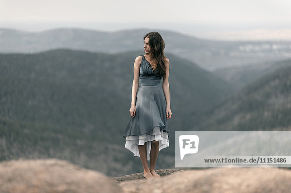 Caucasian woman standing on remote mountaintop