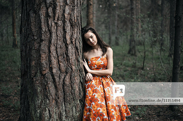 Caucasian woman standing in forest