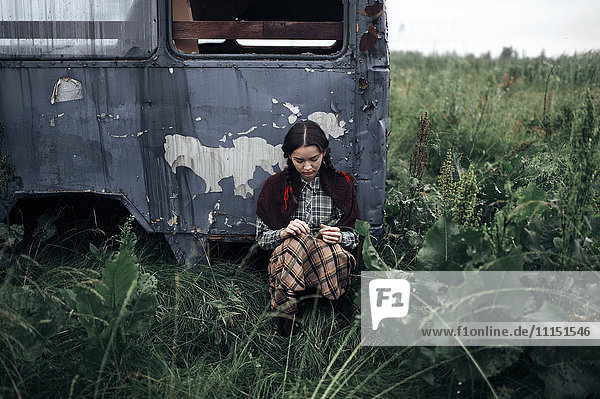 Caucasian woman sitting near antique truck