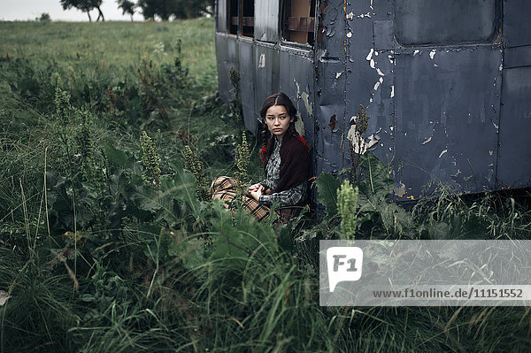Caucasian woman sitting near remote field