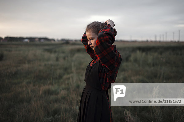 Caucasian woman standing in remote field