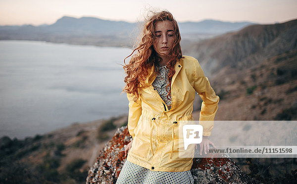 Caucasian woman standing on coastal hillside