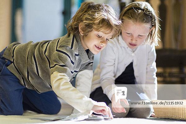 Children working together on floor in classroom
