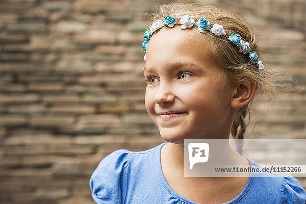 Smiling Caucasian girl wearing flower crown Smiling Caucasian girl wearing flower crown