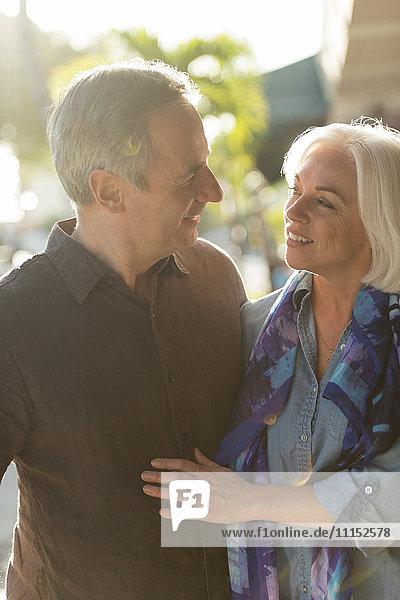 Older Caucasian couple walking outdoors