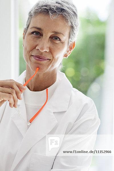 Close up of doctor holding eyeglasses