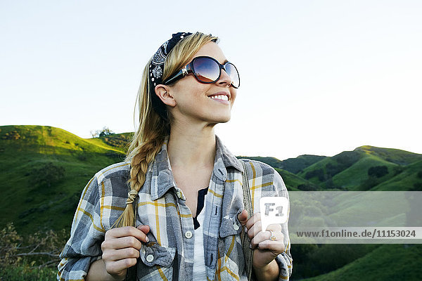Caucasian woman smiling on rural hilltop Caucasian woman smiling on rural hilltop
