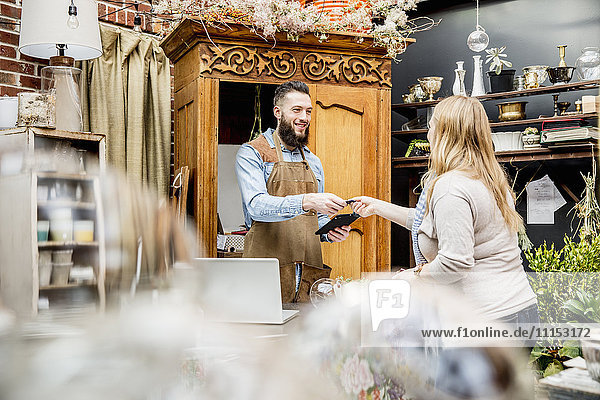 Employee helping customer shopping in store