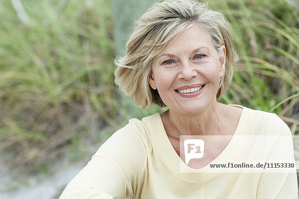 Older Caucasian woman smiling outdoors