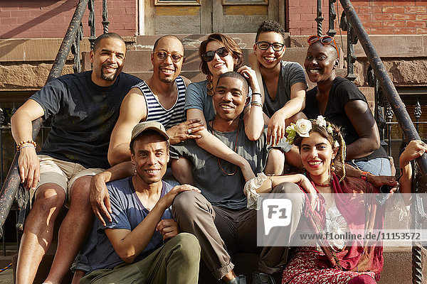 Friends smiling on front stoop