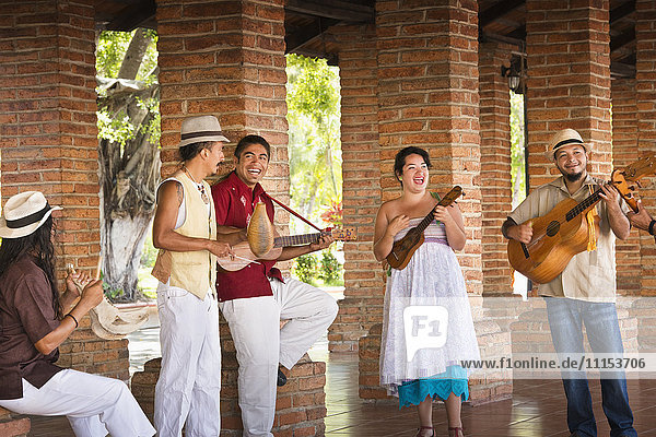 Musicians performing in courtyard