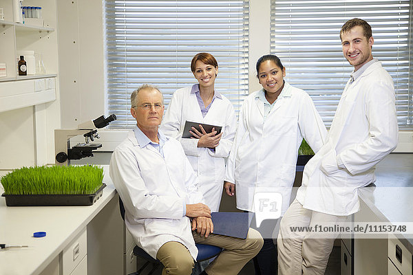 Scientists posing in laboratory