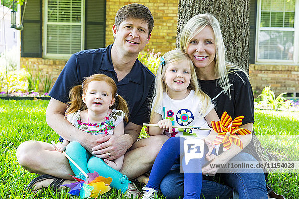 Caucasian family smiling in backyard