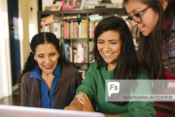 Multi-generation family of women using computer