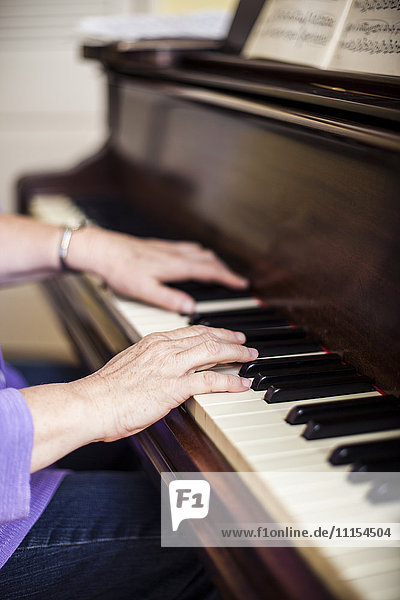 Close up of Caucasian woman musician playing piano