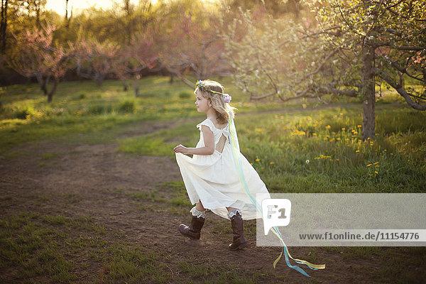 Caucasian girl walking on dirt path