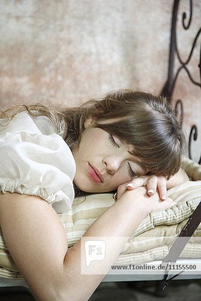 Caucasian woman sleeping on bed