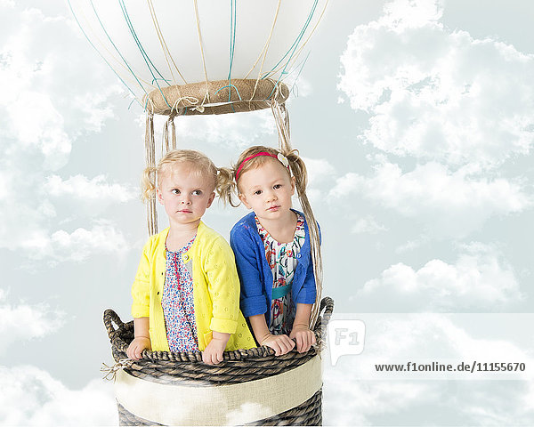 Girls playing in pretend hot air balloon