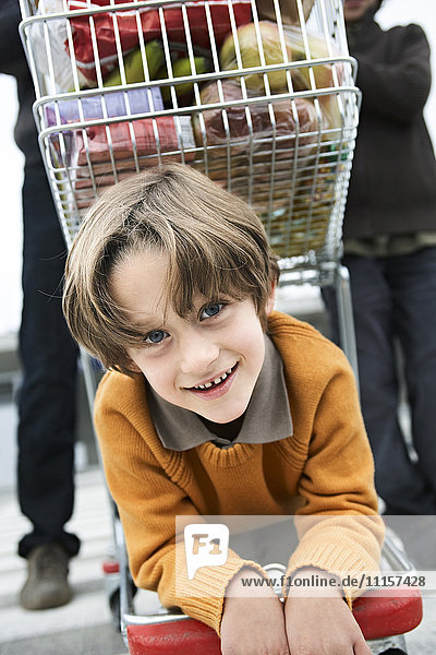 Boy goes shopping with his family
