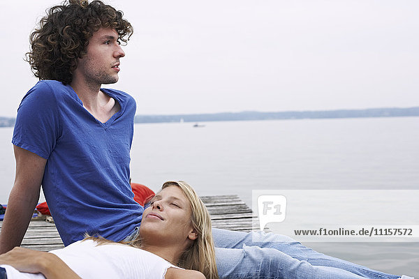 Young couple resting at a lake