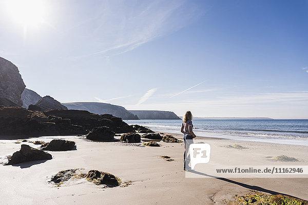 France  Crozon peninsula  teenage girl standing on the beach