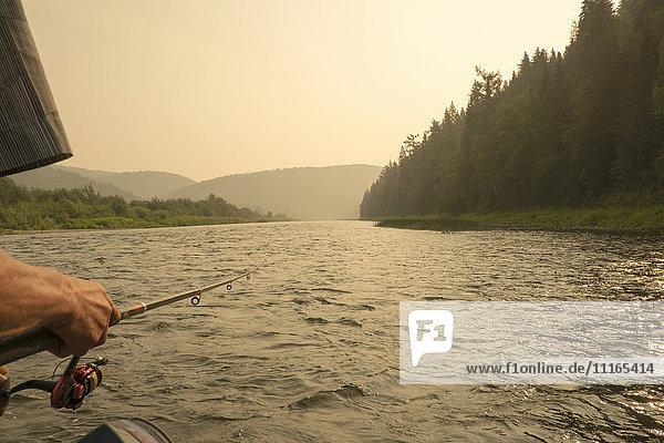 Caucasian woman fishing in river