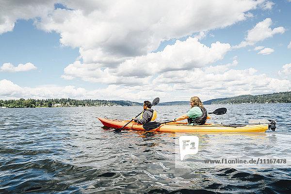 Man and woman paddling kayak