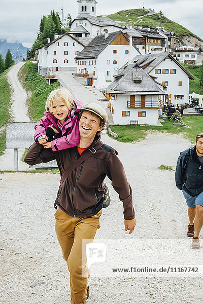 Caucasian father carrying daughter  Tarvisio  Vienna  Austria