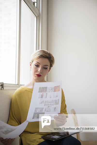 Caucasian woman examining paperwork
