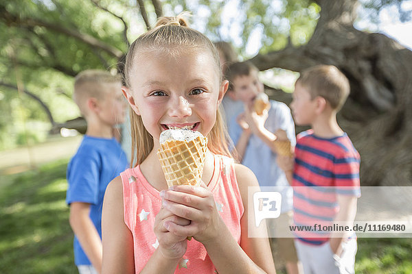Caucasian girl eating ice cream cone
