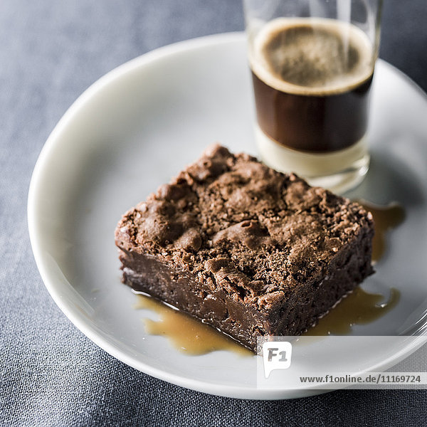 Brownie on plate with espresso