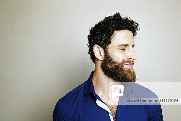 Caucasian man with beard with eyes closed Caucasian man with beard with eyes closed