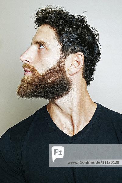 Curious Caucasian man with beard looking up Curious Caucasian man with beard looking up