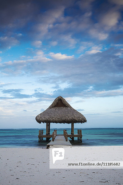 Dominican Republic  Punta Cana  Playa Blanca  Wooden pier with thatched hut
