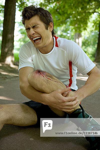 Skater injured and clutching leg