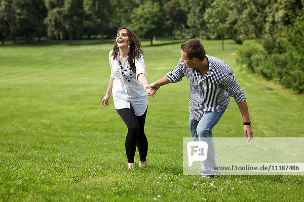 Young couple enjoying in park