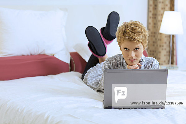 Woman at Home with Laptop Computer