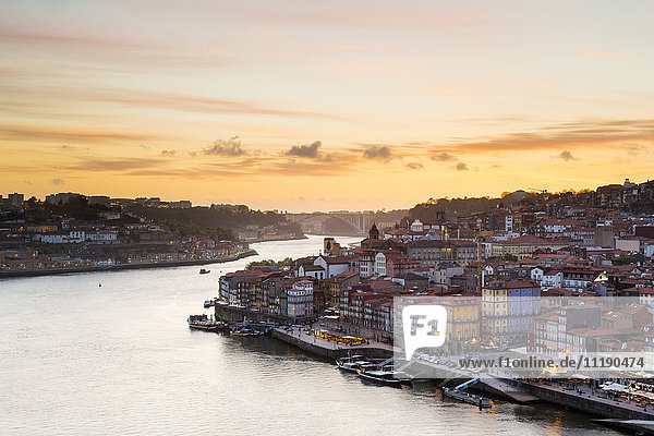 Portugal  Douro Litoral  Porto. Sunset over the UNESCO listed Ribeira district  viewed from Dom Luis I bridge