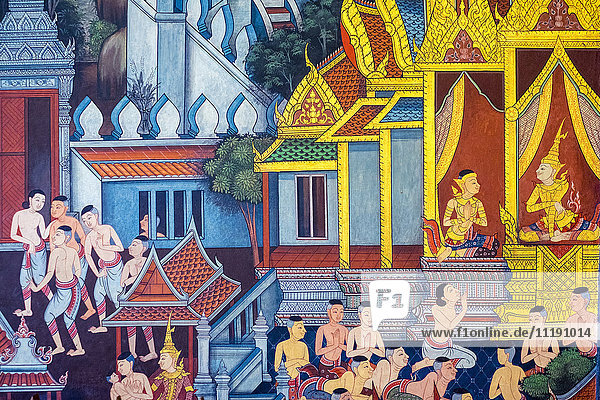 Colorful painted murals depicting scenes from life of Buddha  inside Wat Pho (Temple of the Reclining Buddha)  Bangkok  Thailand