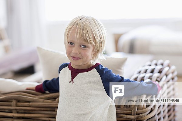 Portrait of a happy little boy in living room
