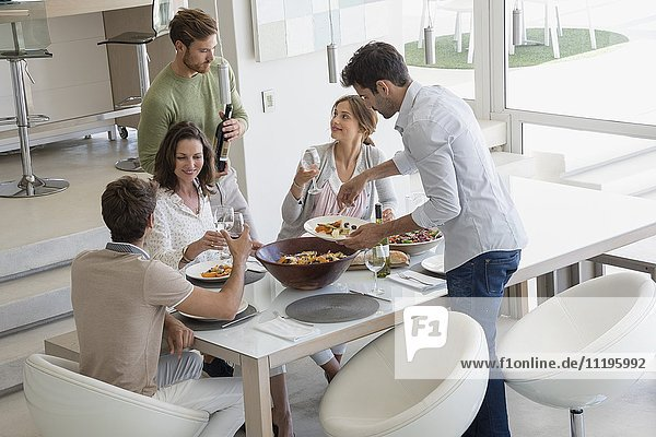 Group of friends enjoying party at home
