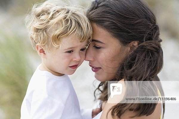 Close-up of a woman loving with her son