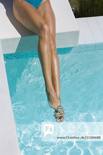 Low section view of a woman at the poolside
