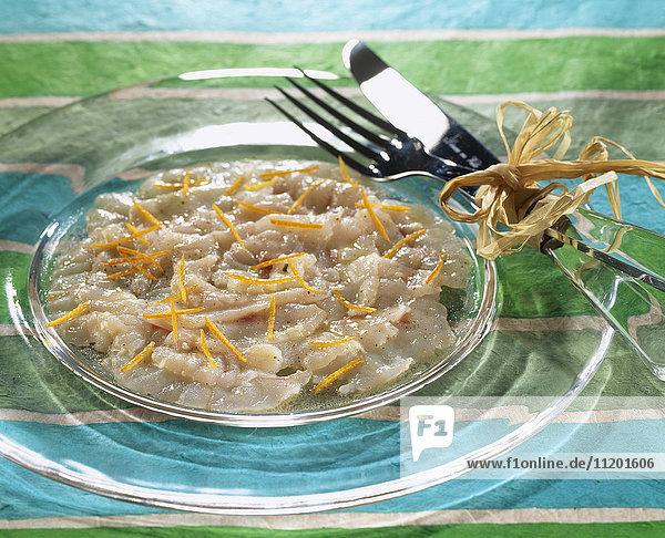 Sea bream carpaccio with orange zests